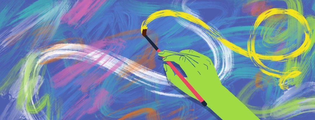 A hand paints a colorful painting with a brush as part of paint therapy for insomnia