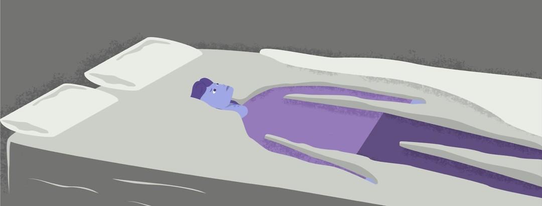 a woman sinking into a mattress