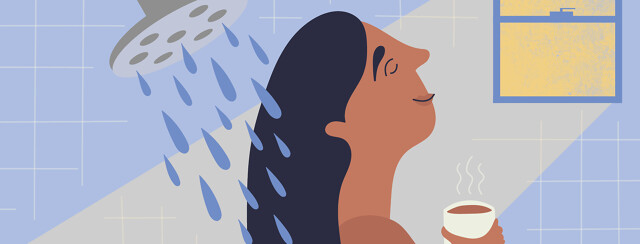 a woman stands in a shower with light shining on her happy face while she holds a cup of coffee