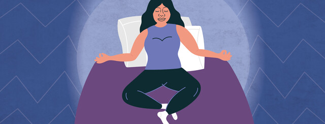 a woman meditating in her bed