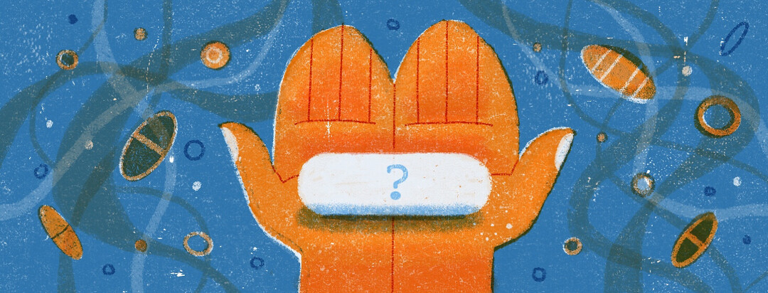 a pair of hands holding a pill with a question mark on it